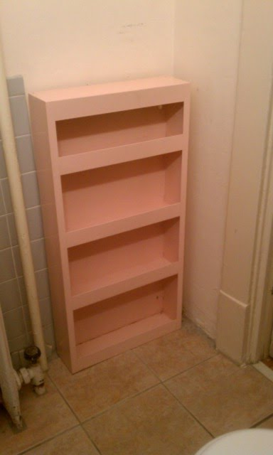 nice old pink metal cabinet .. from thrift store to bathroom